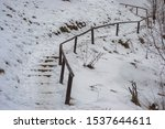 Wooden Stairs On A Hill Covere...