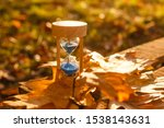 Autumn time theme  sandglass on ...