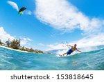 young man kiteboarding  fun in... | Shutterstock . vector #153818645