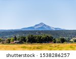 Wilson mountain view from highway 145 in San Juan region of Colorado with agriculture field on summer sunny day with sky - stock photo