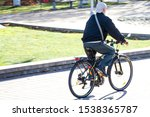 Small photo of Elderly man on a bicycle. Healthy lifestyle in old age. Retired Freedom. Sports of the elderly. Unbending character.