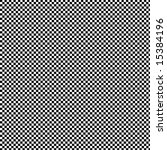 A fine checkerboard pattern of black and white squares. - stock photo