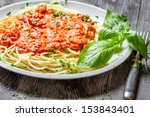 Spaghetti bolognese with shrimps and basil - stock photo