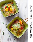 Thai soup with prawns and noodles - stock photo