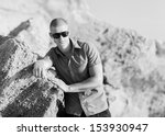 fashion man on the beach | Shutterstock . vector #153930947
