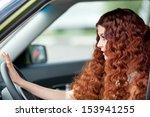 woman sitting in car | Shutterstock . vector #153941255