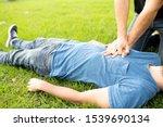 First Aid Emergency CPR rcp on Heart Attack Man , Resuscitation cardiopulmonary, coronavirus covid19