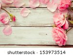 Stock photo romantic floral frame background valentines day background pink roses on wooden background 153973514