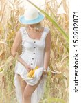Young woman in the corn field with white dress - stock photo