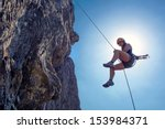 Young  Tough  Woman  Abseiling...