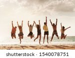 Group Of Happy Friends Jumps...