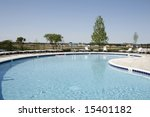 pool with chairs on patio | Shutterstock . vector #15401182