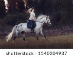 Beautiful Young Lady Riding A...