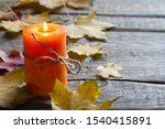 Autumn Leaves And Candle On...