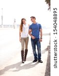 young couple walking in the... | Shutterstock . vector #154048895