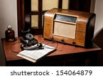 A Table With An Old Radio And...