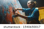 Talented Innovative Female Artist Draws with Her Hands on the Large Canvas, Using Fingers She Creates Colorful, Emotional, Sensual Oil Painting. Contemporary Painter Creating Abstract Modern Art