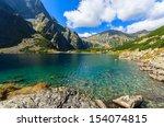 czarny staw alpine lake near...   Shutterstock . vector #154074815
