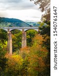 Small photo of Pontcysyllte Aqueduct is a navigable aqueduct that carries the Llangollen Canal across the River Dee in the Vale of Llangollen in north east Wales, UK. Autumn Scenery