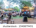 Small photo of BANGKOK,THAILAND-March 2019-People buying, eating food and drinks at outdoor street food night market in a park. Market Stalls. Outdoor market. Food Event. Food Fair. Festival. Flea Market. Bazaar.