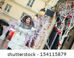 Girl walking on a street decorated for Christmas - stock photo