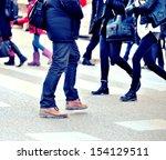 pedestrians on zebra crossing | Shutterstock . vector #154129511