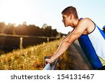 young athlete resting after... | Shutterstock . vector #154131467