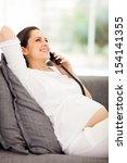 joyful young pregnant woman... | Shutterstock . vector #154141355