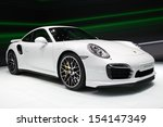 Small photo of FRANKFURT, GERMANY - SEP 13: Porsche 911 Turbo S at the IAA motor show on Sep 13, 2013 in Frankfurt. More than 1.000 exhibitors from 35 countries are present at the world's largest motor show.