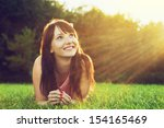 young pretty woman lying on the ... | Shutterstock . vector #154165469