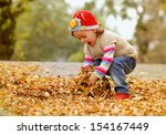 Cute Child Playing With Autumn...