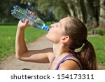 attractive sporty woman... | Shutterstock . vector #154173311