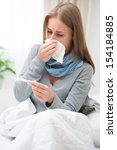 sick woman with thermometer in...   Shutterstock . vector #154184885