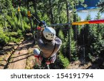 woman sliding on a zip line in... | Shutterstock . vector #154191794