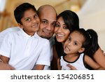 family sitting together while...   Shutterstock . vector #154206851