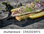 Stock photo dutch style herring with dill red onion and red pepper 1542323471