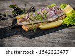 Stock photo dutch style herring with dill red onion and red pepper 1542323477