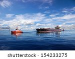 Tanker Ship Being Guided Into...