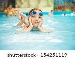 beautiful little girl in pool... | Shutterstock . vector #154251119