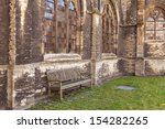 Medieval abbey yard with wooden bench in Gent, Belgium  - stock photo