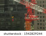 Small photo of Closeup red crane in the city, Crane with building.