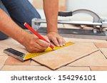 laying ceramic floor tiles  ...   Shutterstock . vector #154296101
