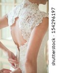 bride putting on her white... | Shutterstock . vector #154296197