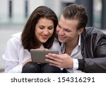 young couple using tablet | Shutterstock . vector #154316291