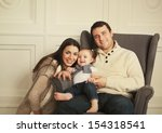 happy smiling family with one...   Shutterstock . vector #154318541
