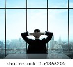 Relaxed Businessman Sitting In...