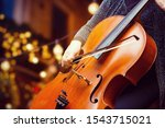 A Young Girl Plays The Cello I...