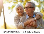 Elderly Couple Embracing In...