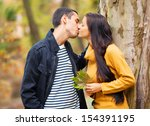 couple kissing outdoor in the... | Shutterstock . vector #154391195