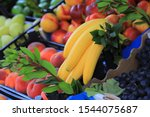 Yellow bananas and fruits on a...
